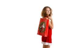 Girl with christmas shopping bag stock photography