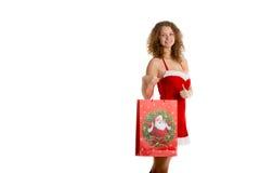 Girl with christmas shopping bag stock image