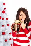 Girl with christmas surprise Stock Photos