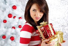 Girl with christmas surprise Stock Images