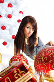 Girl with christmas surprise Stock Photo