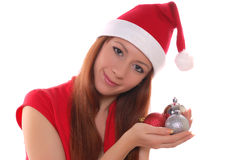 Girl and christmas toys Stock Images