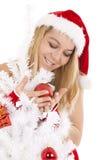 Girl and christmas tree Stock Image