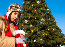 Girl with Christmas tree. Girl holding a bag with Christmas presents Royalty Free Stock Photo