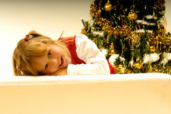 Girl by Christmas Tree Stock Photography
