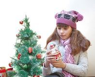 Girl by Christmas tree Royalty Free Stock Photos