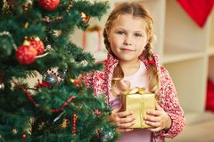 Girl by Christmas tree Royalty Free Stock Image