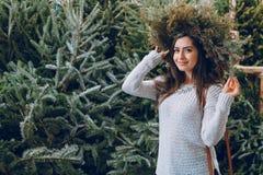 Girl and Christmas tree Royalty Free Stock Image