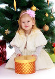The girl at the Christmas tree Stock Photos