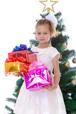 The girl at the Christmas tree Stock Images