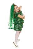 Girl in Christmas tree costume stock photo