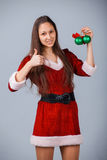 Girl with Christmas tree decoration Stock Photography