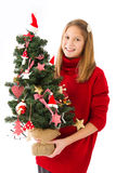Girl with Christmas tree in hand Stock Photos