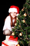 Girl with christmas tree and presents over dark Stock Image