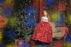 Girl  at the Christmas tree Royalty Free Stock Photo