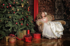 Girl  at the Christmas tree Royalty Free Stock Images