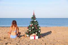 Girl on Christmas vacation on a beach resort stock photo