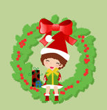 Girl and christmas wreath Royalty Free Stock Photos