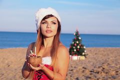 Girl Christmasat a resort in the South by the sea royalty free stock image