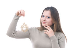 Girl with the christmass toy in her hand. Portrait of girl with the christmass toy in her hand isolated on white Stock Image