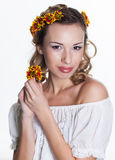 Girl with chrysanthemum wreath Royalty Free Stock Photo