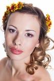 Girl with chrysanthemum wreath Stock Image