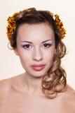 Girl with chrysanthemum wreath Stock Photos