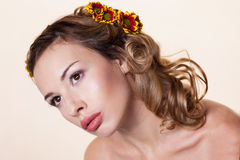 Girl with chrysanthemum wreath Stock Image