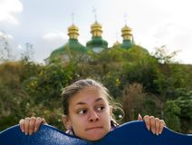 The girl and the church. Royalty Free Stock Photos
