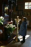 Girl in church Royalty Free Stock Photo