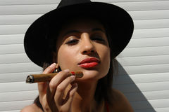 The girl  with the cigar Royalty Free Stock Photos