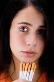 Girl and cigaretes Royalty Free Stock Image