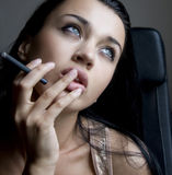 Girl with cigarette Stock Image