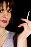 Girl with a cigarette Stock Images