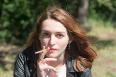 Girl with a cigarette Royalty Free Stock Photo