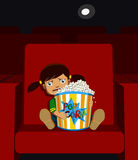 Girl in a cinema Royalty Free Stock Image