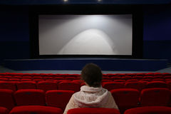 Girl in cinema Stock Photography