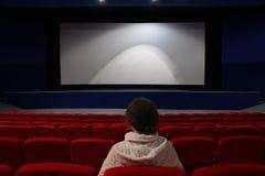 Girl in cinema stock photography