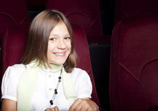 Girl at the cinema Stock Photos