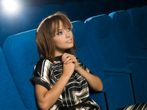 Girl in cinema Stock Images