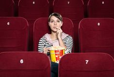 A girl at the cinema royalty free stock image