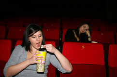 Girl is in cinema. Look a film Royalty Free Stock Images