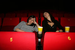 Girl is in cinema. Girls are in the cinema,  sleep to view of film Royalty Free Stock Photos