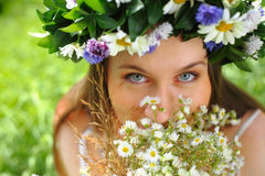 Girl with circlet of flowers. Portrait of a girl with circlet of flowers Royalty Free Stock Images