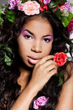 Girl with circlet of flowers. Elegant mulatto girl with circlet of flowers Stock Photos