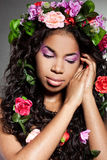 Girl with circlet of flowers. Elegant mulatto girl with circlet of flowers Stock Images