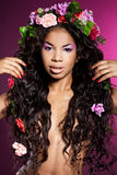 Girl with circlet of flowers. Elegant mulatto girl with circlet of flowers Stock Photo