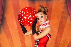 Girl circus with a ball royalty free stock image