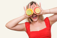 Girl with citrus Royalty Free Stock Image