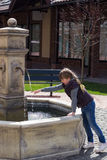 Girl in city fountain Royalty Free Stock Images